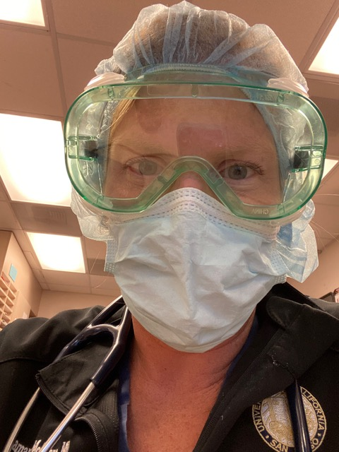 Dr. Sam McGlone with PPE on