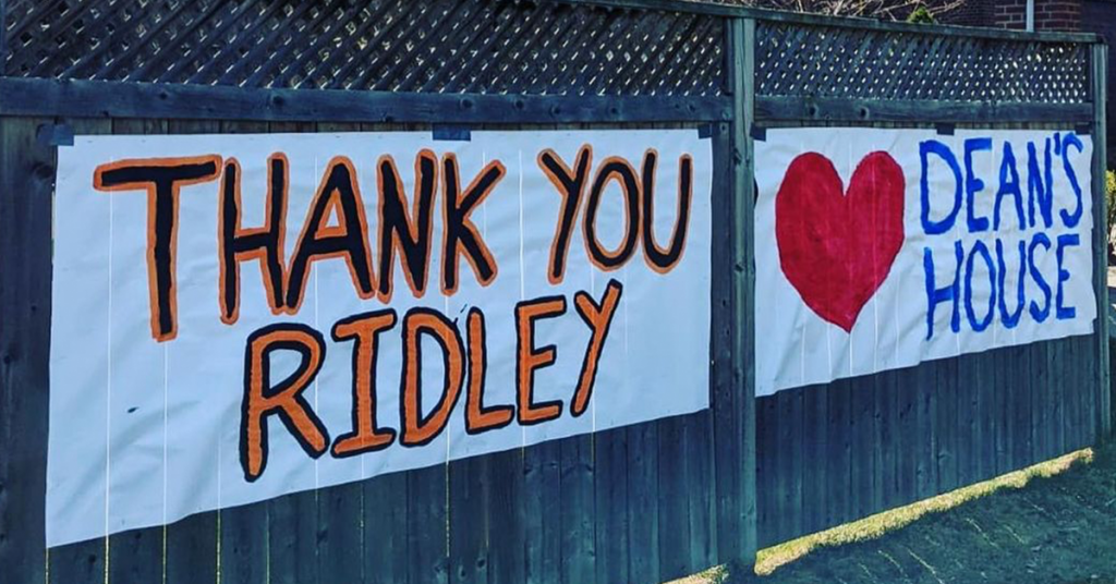 signs posted on fence that read Thank You Ridley and Dean's House with a heart