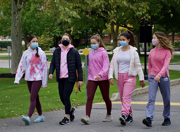 five female students participating in CIBC run for the cure