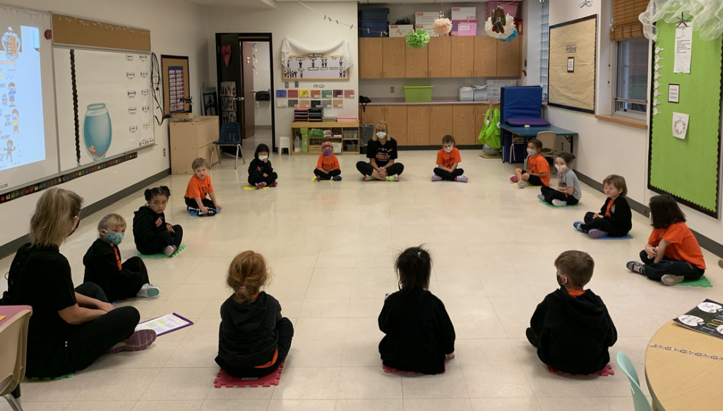 Lower School students sitting in a circle in a classroom