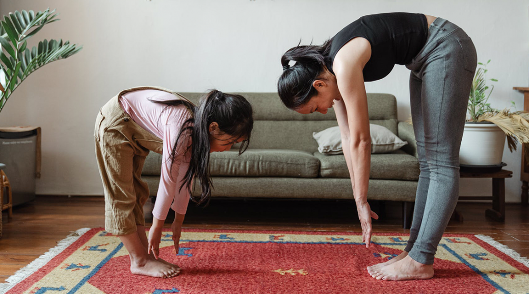Mom and daughter practicing yoga